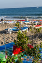 Sun loungers on beach in suuny day Stock Images