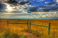 Sun lowering in the late afternoon skies over the midwestern plains HDR Royalty Free Stock Photo
