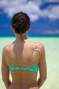 Sun made with suncream at the woman s shoulder this image has attached release Royalty Free Stock Photography