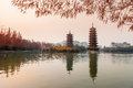 Sun moon towers in sunset guilin double and at shanhu lake the golden tower built with copper is a nine storeyed architecture of Stock Images