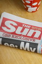 The sun newspaper bracknell united kingdom january a rolled up copy of is a daily in uk and has been in Royalty Free Stock Photography