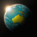 Sun over australia on planet earth blue black background highly detailed surface elements of this image furnished by Royalty Free Stock Photography