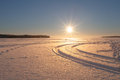 Sun over frozen field and snowed Stock Photo
