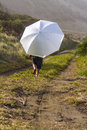 Sun proctection a small child using an umbrella for protection down at the beach location new zealand kaikoura Stock Images