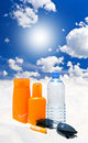 Sun protection cream, water and sunglasses Royalty Free Stock Photo