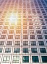 Sun ray and blue sky reflection on window office building, busin Royalty Free Stock Photo