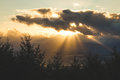 Sun rays from behind a cloud Royalty Free Stock Photo
