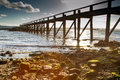 Sun rays bursting through pier Royalty Free Stock Photography