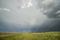 Sun rays radiate through the mist after a passing storm. Royalty Free Stock Photo