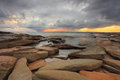 Sun rays, rocks and storm clouds Royalty Free Stock Photo
