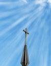 Sun rays shining down on cross Royalty Free Stock Image