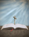 Sun rays shining down on cross with bible concept of from heaven a christian Royalty Free Stock Photos
