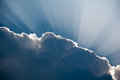 Sun rays shinning through a dark cloud Royalty Free Stock Photo