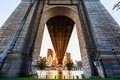 Sun rays under queensboro bridge at sunset on roosevelt island new york Royalty Free Stock Image