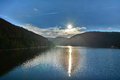 Sun reflected in the lake picture taken at fantanele belis dam from transylvania romania europe Royalty Free Stock Photography