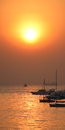 Sun rise captured with boats below Royalty Free Stock Photo