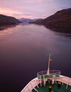 Sun rises on a new voyage the bow of large boat glides through still waters in chilean fjords at sunrise Stock Photography