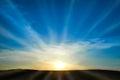 Sun rising on the blue sky Royalty Free Stock Photo