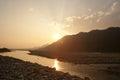 Sun set on the banks of Amochu river at Phuntsholing Royalty Free Stock Photo