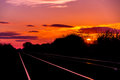 Sun set rise at railway tracks Royalty Free Stock Photo