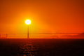 The sun setting behind the Golden Gate Bridge in the San Francisco Bay. Royalty Free Stock Photo
