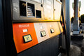 Sun setting on gasoline pump Royalty Free Stock Photo