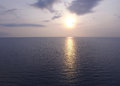The sun setting over the calm sea in Thailand Royalty Free Stock Photo
