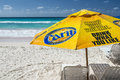 Sun shade on accra beach barbados yellow carib beer the white sands of the south coast of carib is a beer brewed by carib Royalty Free Stock Photos
