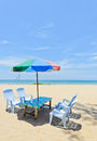 Sun shade with chairs at tropical beach Stock Photography