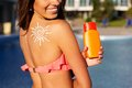 Sun shape drawing from sunscreen lotion on girls shoulder Royalty Free Stock Photo