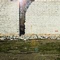 The sun shines behind a brick wall old Royalty Free Stock Image