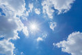 The sun shines bright in the daytime in summer. Blue sky and clouds. Royalty Free Stock Photo