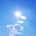 sun shines with white clouds Royalty Free Stock Photo