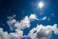 Sun shining in blue sky Royalty Free Stock Photo