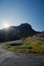 Sun shining on the road through mountain plateau valdresflye jotunheimen norway Royalty Free Stock Photos