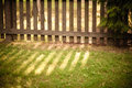 Sun shining through wooden fence see my other works in portfolio Stock Image