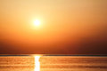 The sun in the sky at sunrise beautiful golden as seen from beach rhodes greece Stock Image