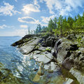 Sun and stony shore of ladoga lake karelia russia Royalty Free Stock Photos