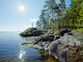 Sun and stony shore of ladoga lake karelia russia Royalty Free Stock Image