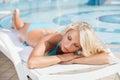 Sun tanning. Beautiful young women in bikini lying on the deck c Royalty Free Stock Photo