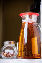 Sun tea pitcher of brewing on a windowsill Stock Photos