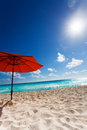 Sun and umbrella on the beach orange white sand beautiful sky Stock Image
