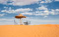 Sun umbrella and chairs in desert morocco Royalty Free Stock Image