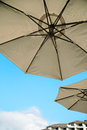 Sun umbrella in the resorts a sunny day several sunshades of stand under blue sky Stock Photo