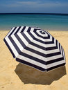 Sun umbrella on a sandy beach Stock Photography