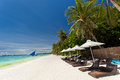 Sun umbrellas and beach chairs on tropical coastline philippines boracay Royalty Free Stock Photo