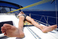 Sunbath on deck of a sailboat turkey wide angle view young caucasian man taking sunbathe sailing boat yacht getting tanned under Royalty Free Stock Photography