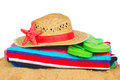 Sunbathing accessories and straw hat on sand isolated on white background Stock Photos