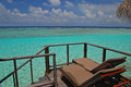Sunbathing facility on your balcony with endless sea view private overwater villa of crystal clear beautiful blue turquoise water Stock Photo