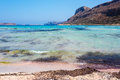 Sunbathing people on gritty beach of Balos lagoone on Crete. Greece. Royalty Free Stock Photo